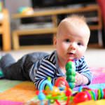 Bellies Down, Bottoms Up: Tummy Time Milestones & Activities