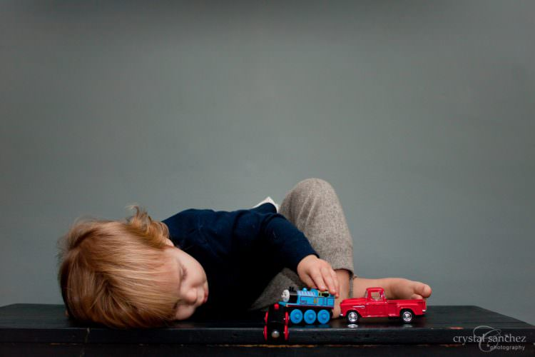 Sliding and Rolling a Toy Baby Cognitive Development Milestone