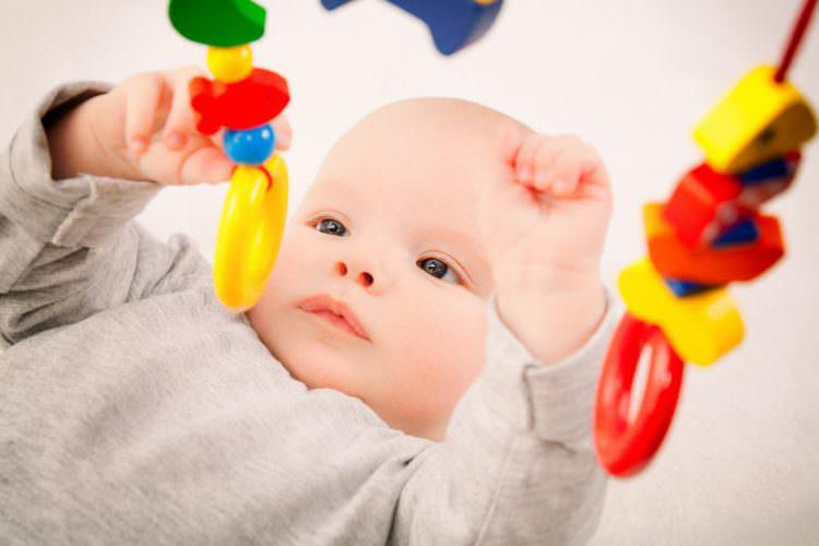 holding a toy developmental milestone
