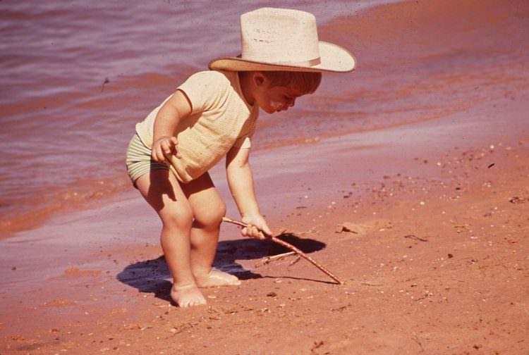 pick up toy while standing walking developmental milestone