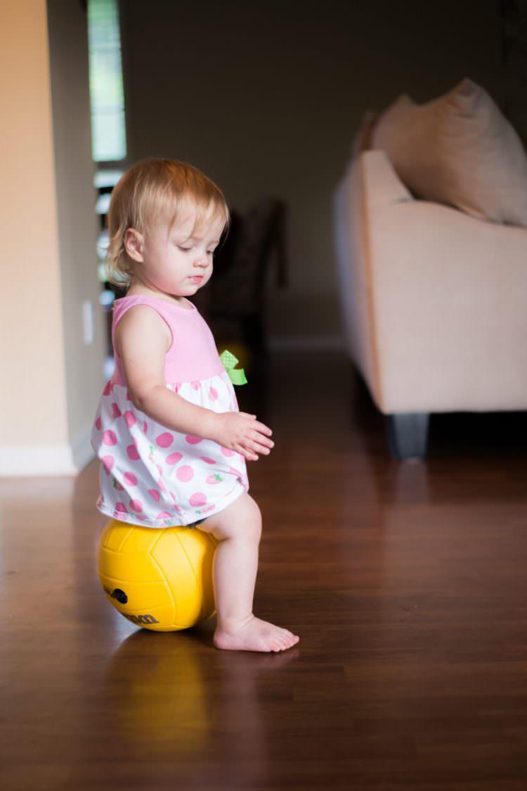 baby standing developmental milestone