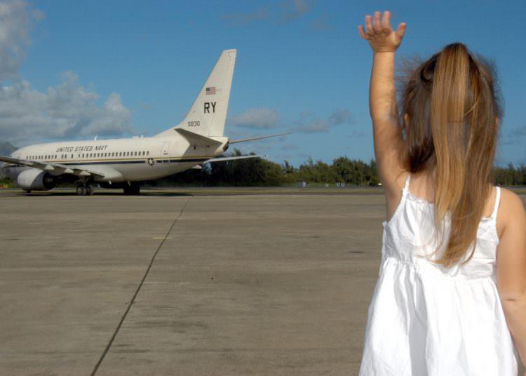 toddler waving bye-bye milestone